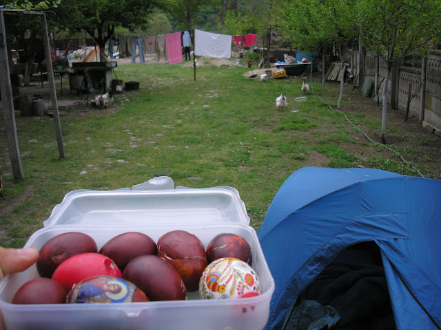 My campsite in someones garden. Chickens in background, red eggs in foreground.