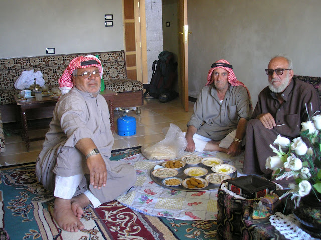 Head towels, full length robes, eating off the floor. This is Syria where Arabia really starts.