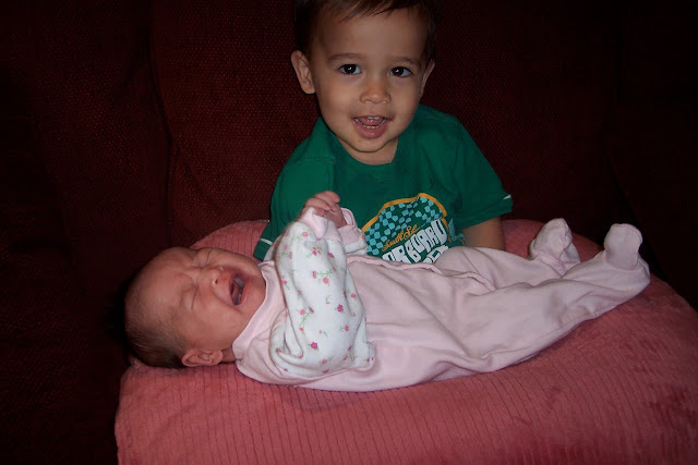 Not quite enjoying big brother holding her