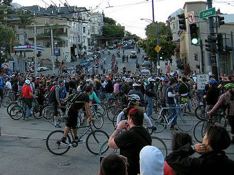 Critical Mass riders fill the intersection of Market and Castro streets in 2005.