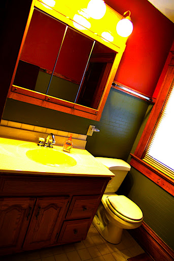 Another view of the bathroom - not quite this yellow.  Well probably replace the towel racks and paint the walls.