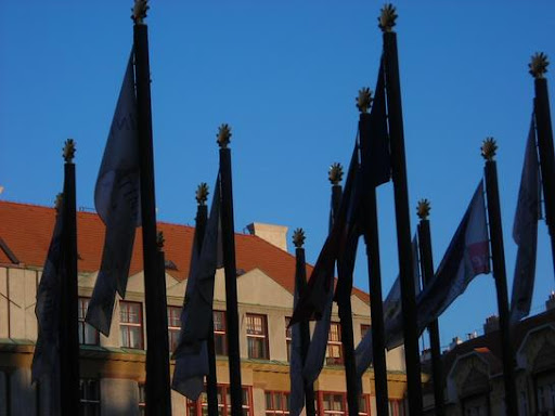 Flags in Prague in shadow