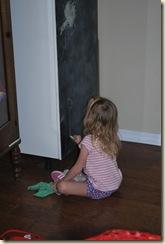 little girl creating