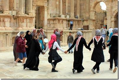 Kay joined these Jordanian Muslim women and girls dancing in the theater, Jerash, Jordan