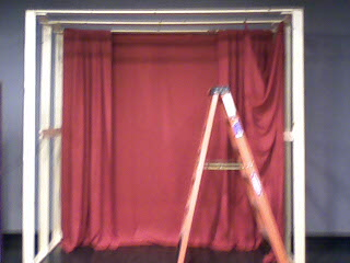 Our bare set, after wed just begun to hang fabric