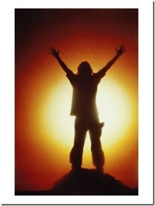 Victorious-Climber-Silhouetted-by-the-Sun-Photographic-Print-C12029818