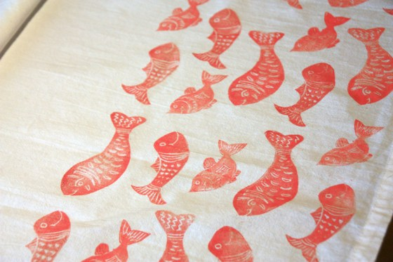 Fish block printed on tea towels joyful roots