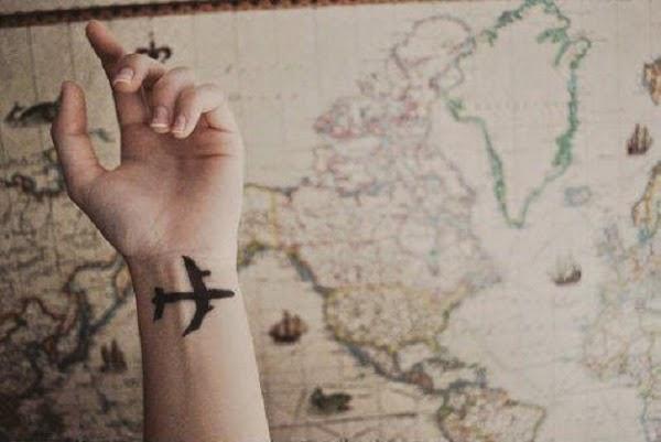 small aeroplane tattoo on wrist