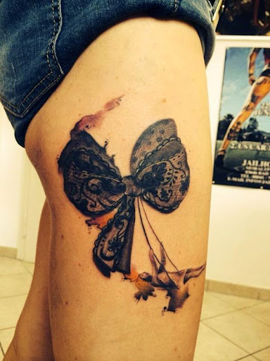 bow tattoos for girls on thig