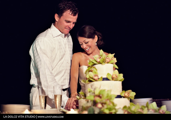 St. Simons Wedding Cake with navy ribbon and green cymbidium orchid