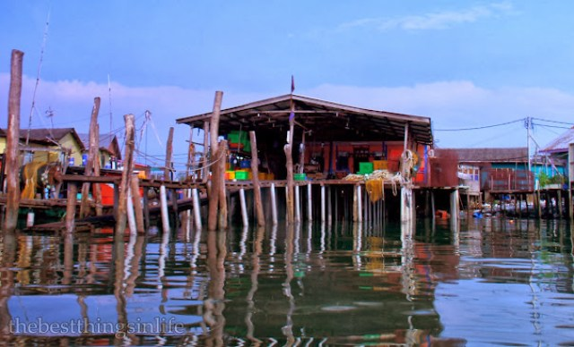 A stilted wooden house, before reaching the Pulau Ketam jetty.