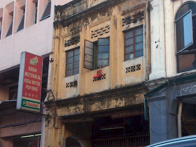 Image of an altar hanging outside a second floor window somewhere in KL