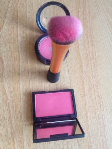 Comparing the pigmentation of Sleek's Flamingo blush and Mac's Dollymix blush