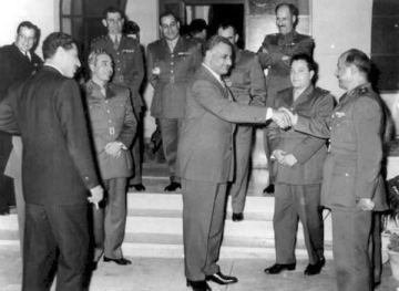 Nasser with Syrian delegation pushing for unity between Syria and Egypt. He is shaking hands with Afif al-Bizri.