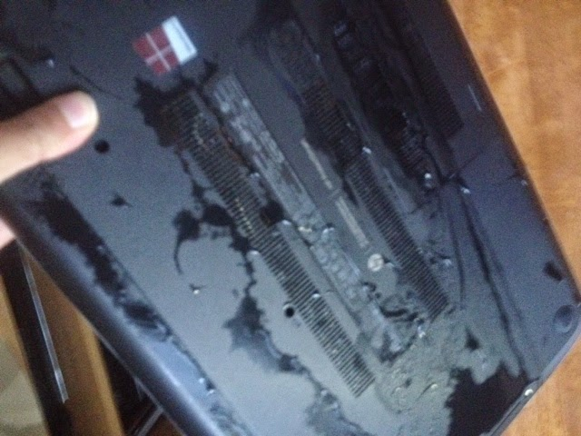 laptop covered in water