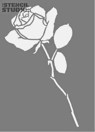Stencil de rosas en el cabecero de la cama.