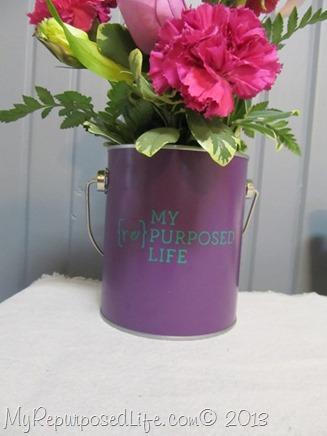 fowers in paint bucket