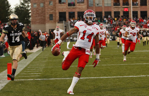 Utah Utes wide receiver Reggie Dunn returns a kick for a touchdown in the fourth quarter as the Colorado Buffaloes host the University of Utah in Boulder