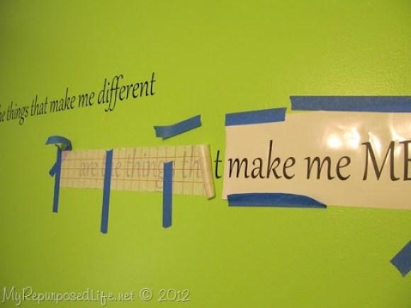 Applying Vinyl Saying on Wall (2)