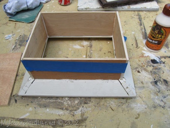 using painters tape to clamp wood