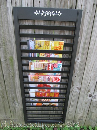 magazine rack repurposed from bi-fold door