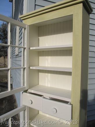 old windows used as cupboard doors