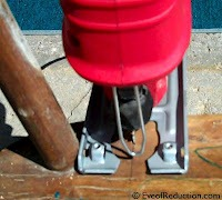 using a jigsaw to cut a chair