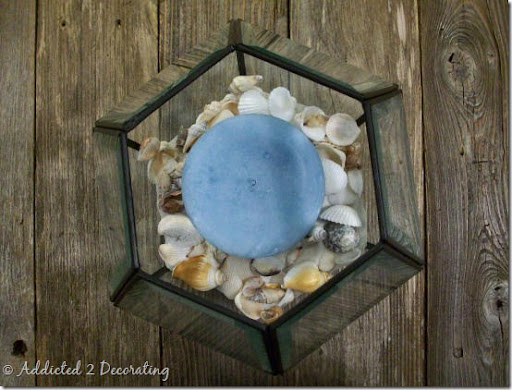 Araña de latón antiguo convertido en un sostenedor de vela