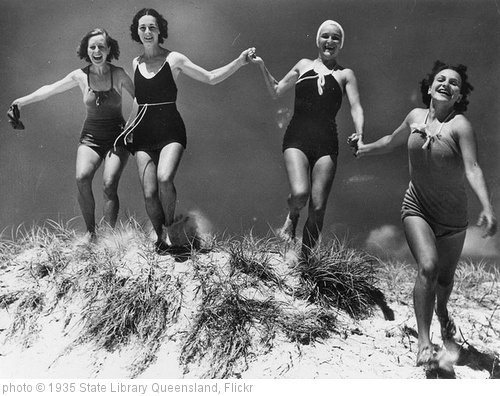 'Young women running over a sand dune on an unidentified beach, ca. 1935' photo (c) 1935, State Library Queensland - license: http://www.flickr.com/commons/usage/