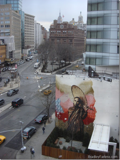 Wall mural at 5th and Bowery, with Cooper Square in the background.