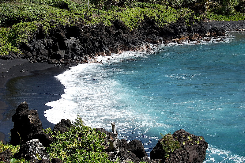 One of the many black sand beaches to play at!