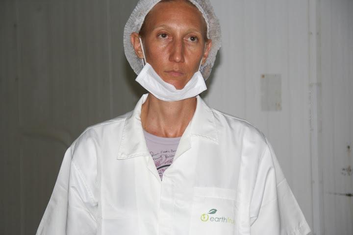MonaVie Black Diamond Onyx Coale wearing an EarthFruits lab coat in Brazil