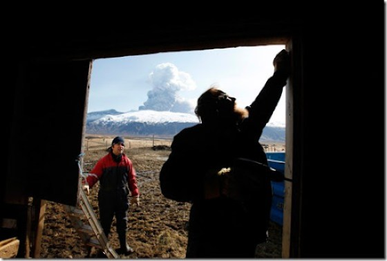 Sheep farmer Thorkell Eiriksson (R) and his brother-in-law Petur Runottsson work to seal a sheep barn, in case winds shift and ash from a volcano erupting across the valley lands on their farm, in Eyjafjallajokull April 17, 2010. The current season is when the spring lambs are born and such young animals are especially susceptible to volcanic ash in their lungs so they must be stored inside. (REUTERS/Lucas Jackson) #