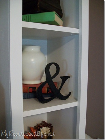 bookshelf with ampersand