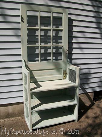 door repurposed into bookshelf