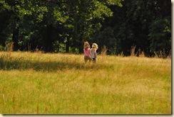 girls in tall grass