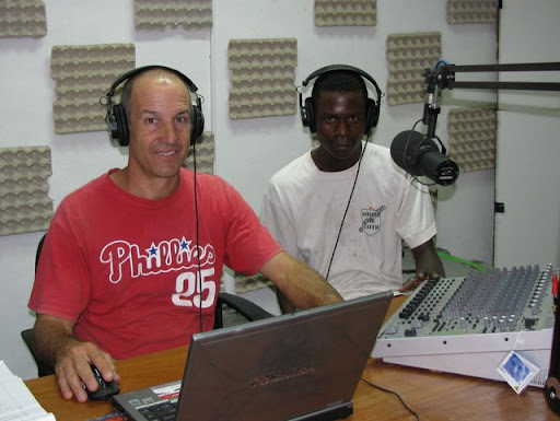 Paul Zimmerman and a local Mwane speaker work together to record program material for Radio Nuru