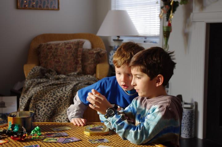 Playing Bakugan with his cousin.