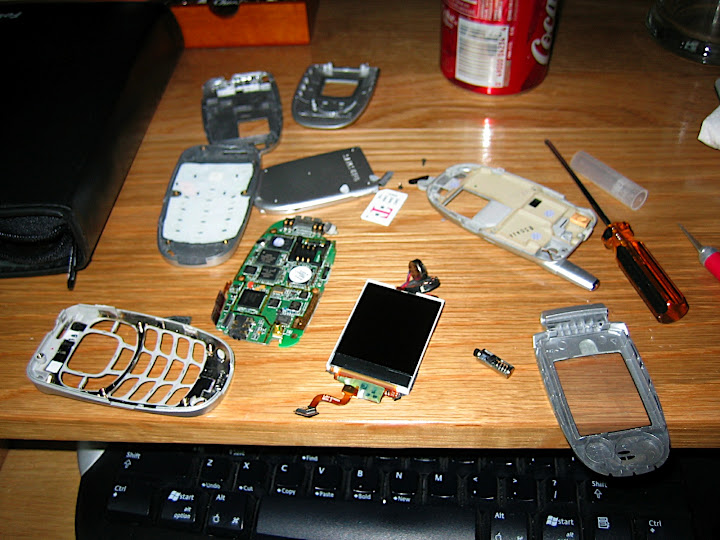 Parts everywhere! Notice there are two sets of plastic in this pic... the old case and the new one.