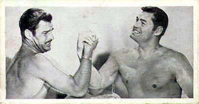 Crabbe and Weissmuller, bare-chested and arm-wrestling