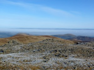 Banks of fog seen from Raise. The Pennines are on the horizon.