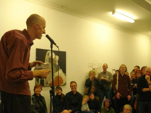 Andy Jackson performing poetry in front of an audience