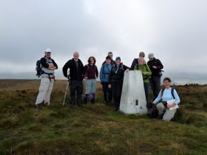 A group photo at Burbage Edge Trig Pillar