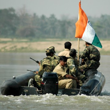 Soldiers of the Indian frontier guard, Border Security Force of India (BSFI) strict vigil on India-Bangladesh International Water (that is, Riverine) Border at Srimantapur village of West Tripura district of Northeastern Indian State, Tripura. (Photo/Shib Shankar Chatterjee)
