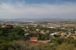 Panoramic view of San Miguel de Allende, Mexico from a small parking on road 111. In a distance, past the MEGA supermarket and Los Frailes, there is lake Ignacio Allende.