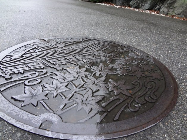 A wet manhole cover