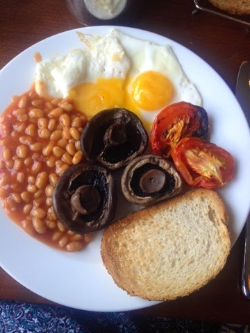 A fry-up of eggs, beans, tomatoes mushrooms and toast the Macdonald Manchester Hotel
