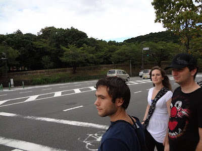 Three of my friends at a crosswalk, wearing adventuring gear