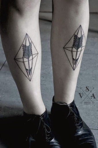 Geometric Arrow tattoos on leg