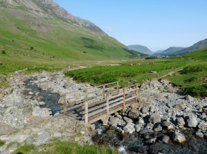 A bridge spans Warnscale Beck with Buttermere just in view. It was a lovely morning. Todays route was something new for Richard and I.